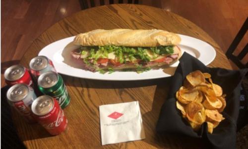 Sub-sandwich, sodas, and chips