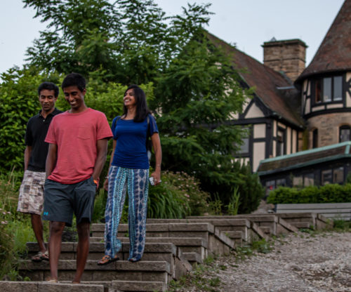 Happy family walking the stone stairs
