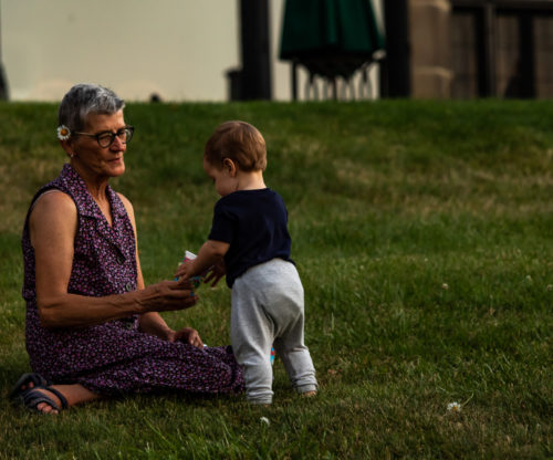 Grandmother playing with her grandson in the yard
