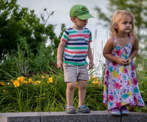 Young brother and sister exploring outside of Punderson Manor
