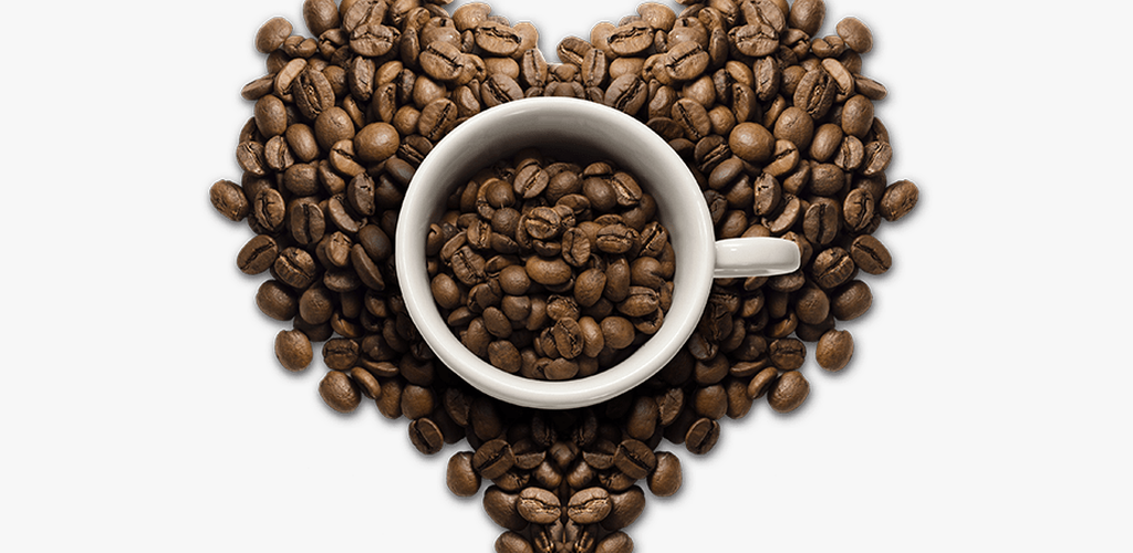 Coffee surrounded by coffee beans