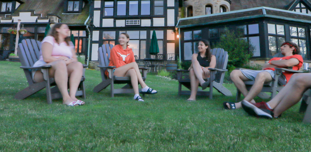 Group of teens hanging out in the yard